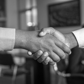 two men shaking hands making a deal