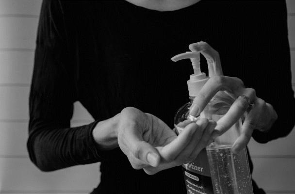 a women sanitising her hands