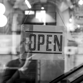 retail open sign on a shop window